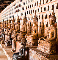 Each pigeon hole in this cloister contains two tiny Buddhas, with over two thousand Buddha images in this temple. (Photo by Matt Considine - Images of Asia Collection)