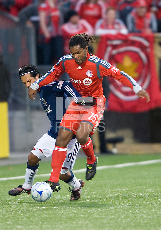22 April 2009: Chivas USA midfielder Jorge Flores #19 and Toronto FC defender Adrian Serioux #15 in action at BMO Field in Toronto in a MLS game between Chivas USA and Toronto FC..Toronto FC won 1-0.