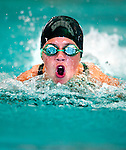 Country Club's Taylor Hulbert competes in the 50 yard fly race during the 53rd annual Country Club Swimming Championships on Tuesday, Aug. 7, 2012, in Kearns, Utah. (© 2012 Douglas C. Pizac)