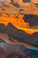 Dead Horse Point State park, UT<br /> Morning sun on the red cliffs of the Goose Neck section of the Colorado River