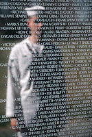 Washington (DC) USA - Oct 1, 1987 - A sailor's image is reflected on the face of the Vietnam Veterans' Memorial.