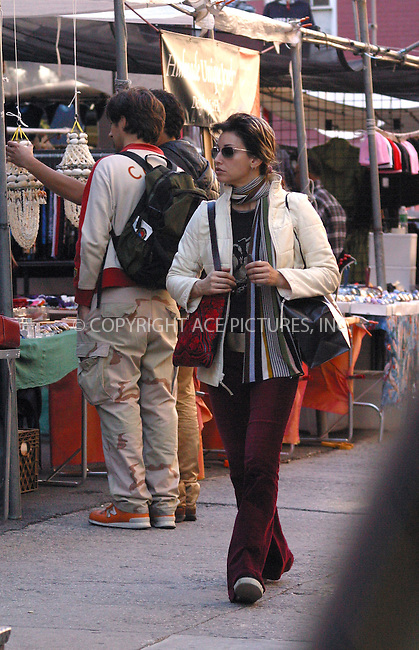 Actress GINA GERSHON spotted on a shopping spree in SoHo. Gina spent several hours observing storefronts, chatting on a cell phone, eating some snacks and shopping at various boutiques including Barneys New York Co-op. New York. October 14, 2002. Please byline: Alecsey Boldeskul/NY Photo Press.   ..*PAY-PER-USE*      ....NY Photo Press:  ..phone (646) 267-6913;   ..e-mail: info@nyphotopress.com