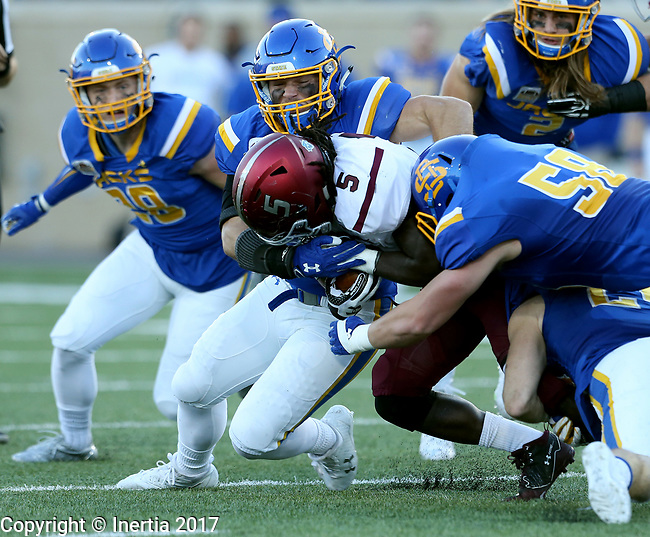 BROOKINGS, SD - OCTOBER 7: Daquan Isom #5 from Southern Illinois is brought down by a trio of defenders including Mason Leiseth #55 from South Dakota State University in the first half of their game Saturday night at Dana J. Dykhouse Stadium in Brookings. (Photo by Dave Eggen/Inertia)