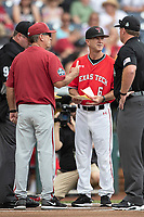 Arkansas Razorbacks head coach Dave Van Horn meets with Texas Tech head coach Tim Tadlock before Game 5 of the NCAA College World Series against the Texas Tech Red Raiders on June 17, 2019 at TD Ameritrade Park in Omaha, Nebraska. Texas Tech defeated Arkansas 5-4. (Andrew Woolley/Four Seam Images)