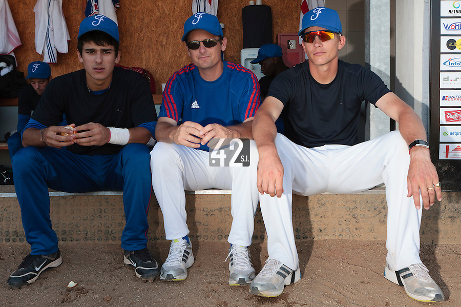 21 August 2010: Rodolphe Le Meur of Team France is seen between Maxime Lefevre and Boris Rothermundt prior to Russia 13-1 win in 7 innings over France, at the 2010 European Championship, under 21, in Brno, Czech Republic.