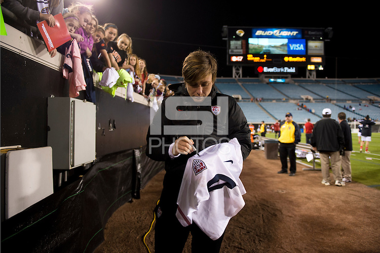 Abby Wambach (20) of the USWNT signs an autograph after the game during the game at EverBank Field in Jacksonville, Florida.  The USWNT defeated Scotland, 4-1.
