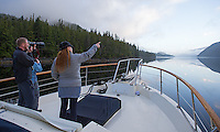 Tourists take in the glorious scenery of the Great Bear Rainforest.