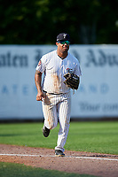 Staten Island Yankees left fielder Canaan Smith (11) jogs back to the dugout during a game against the Lowell Spinners on August 22, 2018 at Richmond County Bank Ballpark in Staten Island, New York.  Staten Island defeated Lowell 10-4.  (Mike Janes/Four Seam Images)