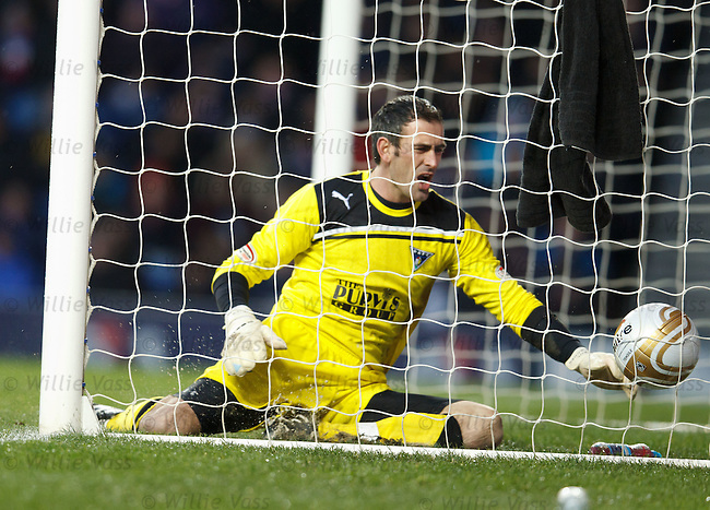 Dunfermline keeper Paul Gallagher tries in vain to keep out the deflected shot to no avail as Rangers take the lead