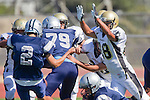 Torrance, CA 09/08/11 - unidentified North players and Issac Kuo (Peninsula #28) in action during the North-Peninsula Junior Varsity Football game at North High School in Torrance.