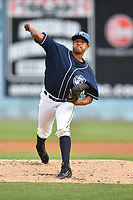 Asheville Tourists stating pitcher Erick Julio (29) delivers a pitch during a game against the Greensboro Grasshoppers at McCormick Field on April 27, 2017 in Asheville, North Carolina. The Tourists defeated the Grasshoppers 8-5. (Tony Farlow/Four Seam Images)