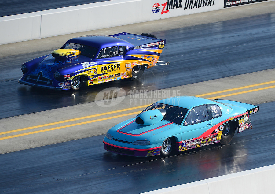 Apr. 14, 2012; Concord, NC, USA: NHRA top sportsman driver Billy Vaughn (near lane) races alongside Jeff Brookes during qualifying for the Four Wide Nationals at zMax Dragway. Mandatory Credit: Mark J. Rebilas-