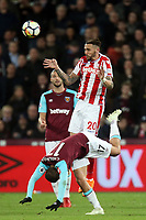 Geoff Cameron of Stoke City and Javier Hernandez of West Ham United during West Ham United vs Stoke City, Premier League Football at The London Stadium on 16th April 2018