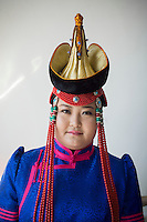 A Mongolian bride wears a traditional headdress for a wedding ceremony in Damao Banner, Inner Mongolia, China, October 2014.