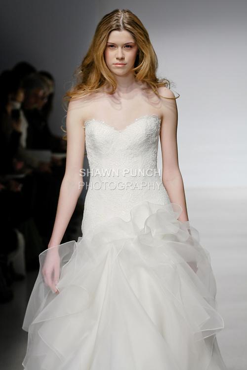 Model walks runway in a Delilah wedding dress by Amsale Aberra, for the Christos Spring 2012 Bridal runway show.
