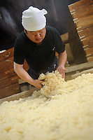 A worker prepares steamed rice, Terada Honke sake brewery, Kozaki, Chiba Prefecture, Japan, June 15, 2009. Terada Honke sake brewery has been brewing sake in the town of Ozaki since 1673. They make sake using organic rice, natural sake yeast, and traditional sake brewing methods.