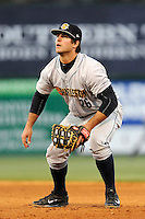 First baseman Mike Ford (26) of the Charleston RiverDogs plays the field in a game against the Greenville Drive on Wednesday, April 16, 2014, at Fluor Field at the West End in Greenville, South Carolina. Charleston won, 8-7. (Tom Priddy/Four Seam Images)