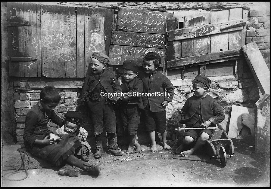 BNPS.co.uk (01202 558833)<br /> Pic: GibsonOfScilly/BNPS<br /> <br /> Penzance urchins around 1890.<br /> <br /> An archive of eye-opening photographs documenting the grim reality of Poldark's Cornwall has emerged for sale for &pound;25,000.<br /> <br /> More than 1,500 black and white images show the gritty lives lived by poverty-stricken families in late 19th and early 20th century Cornwall - around the same time that Winston Graham's famous Poldark novels were set.<br /> <br /> The collection reveals the lowly beginnings of towns like Rock, Fowey, Newquay and St Ives long before they became picture-postcard tourist hotspots.<br /> <br /> Images show young filth-covered children playing barefoot in squalid streets, impoverished families standing around outside the local tax office, and weather-beaten fishwives tending to the day's catch.<br /> <br /> The Cornish archive, comprising 1,200 original photographic prints and 300 glass negative plates, is tipped to fetch &pound;25,000 when it goes under the hammer as one lot at Penzance Auction House.