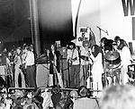 John Lennon 1969 with Jim Price, Bobby Keys, George Harrison, Eric Clapton, Delaney Bramlett, Bonnie Bramlett, Yoko Ono and John Lennon at the Lyceum, December 15th 1969.