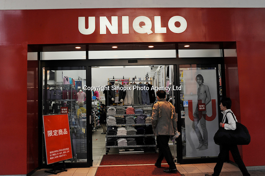 Uniqlo, a cut price clothes store in Tokyo, Japan. Uniqlo is a successful low cost clothing company that is very popular during the recession in Japan..