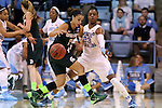 25 March 2014: North Carolina's Diamond DeShields (23) knocks the ball away from Michigan State's Klarissa Bell (21). The University of North Carolina Tar Heels played the Michigan State University Spartans in an NCAA Division I Women's Basketball Tournament First Round game at Cameron Indoor Stadium in Durham, North Carolina. UNC won the game 62-53.