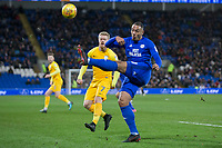 Kenneth Zohore of Cardiff City clears under pressure from Daryl Horgan of Preston North End during the Sky Bet Championship match between Cardiff City and Preston North End at the Cardiff City Stadium, Cardiff, Wales on 29 December 2017. Photo by Mark  Hawkins / PRiME Media Images.