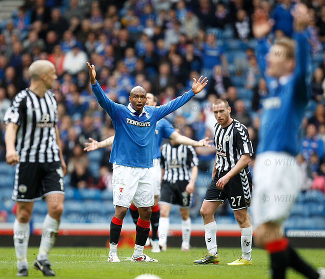 El Hadji Diouf raging as the referee stops play for a foul instead of playing advantage as Rangers break forwards