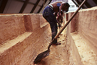 Building Polynesian voyaging canoe, Hawai'iloa - Clarence Au carves out hull (spruce log) of canoe; Halau Waa, Bishop Museum..10/26/91