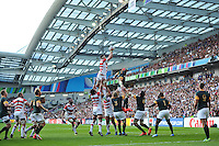 Luke Thompson of Japan rises high to win lineout ball. Rugby World Cup Pool B match between South Africa and Japan on September 19, 2015 at the Brighton Community Stadium in Brighton, England. Photo by: Patrick Khachfe / Onside Images