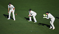 L_R Tim Southee, Tom Latham and BJ Watling.<br /> New Zealand Blackcaps v England. 1st day/night test match. Eden Park, Auckland, New Zealand. Day 4, Sunday 25 March 2018. &copy; Copyright Photo: Andrew Cornaga / www.Photosport.nz