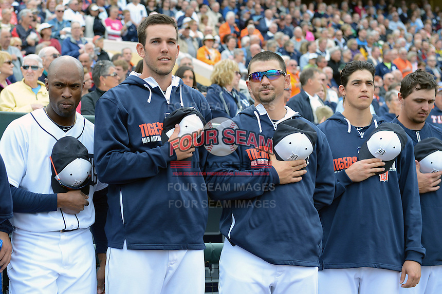 Detroit Tigers Austin Jackson, Drew VerHagen, John Murrian, Kyle Lobstein and Blaine Hardy during the national anthem before a spring training game against the Atlanta Braves on February 27, 2014 at Joker Marchant Stadium in Lakeland, Florida.  Detroit defeated Atlanta 5-2.  (Mike Janes/Four Seam Images)