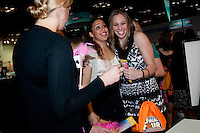 INDIANAPOLIS, IN - APRIL 1, 2011: Kayla Pedersen and Grace Mashore enjoy the festivities at the Cirque du Salute at the Indianapolis Convention Center at Tourney Town during the NCAA Final Four in Indianapolis, IN on April 1, 2011.