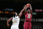 28 January 2016: Florida State's Shakayla Thomas (20) shoots over Wake Forest's Keyonna Allen (21). The Wake Forest University Demon Deacons hosted the Florida State University Seminoles at Lawrence Joel Veterans Memorial Coliseum in Winston-Salem, North Carolina in a 2015-16 NCAA Division I Women's Basketball game. Florida State won the game 96-55.