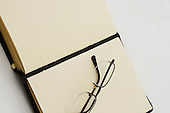 Stock photo of Open Book and reading glasses