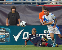 New England Revolution forward Khano Smith (18) crosses while sliding as Puebla FC midfielder Jose Gonzalez (7) defends. The New England Revolution defeated Puebla FC in penalty kicks, in SuperLiga 2010 semifinal at Gillette Stadium on August 4, 2010.
