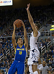 San Jose State guard Isaiah Nichols (10) shoots over Nevada forward Caleb Martin (10) in the second half of an NCAA college basketball game in Reno, Nev., Wednesday, Jan. 9, 2019. (AP Photo/Tom R. Smedes)