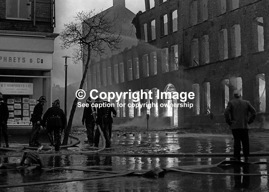Firemen tackle blaze in Dublin Road, Belfast, N Ireland, following Provisional IRA explosions 6th December 1971. 197112060541c<br /> <br /> Copyright Image from Victor Patterson, 54 Dorchester Park, Belfast, UK, BT9 6RJ<br /> <br /> t1: +44 28 9066 1296 (from Rep of Ireland 048 9066 1296)<br /> t2: +44 28 9002 2446 (from Rep of Ireland 048 9002 2446)<br /> m: +44 7802 353836<br /> <br /> victorpattersonbelfast@gmail.com<br /> victorpatterson@me.com<br /> <br /> www.victorpatterson.com<br /> <br /> Please see my Terms and Conditions of Use at https://www.victorpatterson.com/page2<br /> It is IMPORTANT that you familiarise yourself with them.<br /> <br /> Images used on the Internet incur an additional cost and must be visibly watermarked i.e. &copy; Victor Patterson within the body of the image and copyright metadata must not be deleted. Images used on the Internet have a size restriction of 4kbs and are chargeable at rates available at victorpatterson.com.<br /> <br /> This image is available only for the use of the download recipient i.e. television station, newspaper, magazine, book publisher, etc, and must not be passed on to any third party. It is also downloaded on condition that each and every usage is notified within 7 days to victorpatterson@me.com<br /> <br /> The right of Victor Patterson (or the named photographer) to be identified as the author is asserted in accordance with The Copyright Designs And Patents Act (1988). All moral rights are asserted.