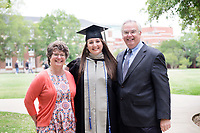 Veterinary Medicine graduate Jennifer Merkle with her parents on the Drill Field.<br />  (photo by Megan Bean / &copy; Mississippi State University)