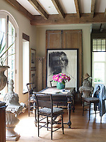 A sunny breakfast area, furnished with reclaimed architectural salvage and antique furniture