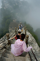 Tourists climbing Mount Hua, one of China's five Sacred Taoist Mountains, in Shaanxi, China.