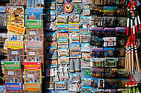 Guidebooks, maps and souvenirs on sale at stall in Piazza di San Giovanni, Tuscany, Italy