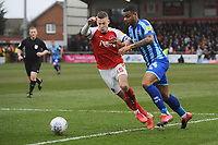 Blackpool's Joe Nuttall vies for possession with Fleetwood Town's Paul Coutts<br /> <br /> Photographer Kevin Barnes/CameraSport<br /> <br /> The EFL Sky Bet League One - Fleetwood Town v Blackpool - Saturday 7th March 2020 - Highbury Stadium - Fleetwood<br /> <br /> World Copyright © 2020 CameraSport. All rights reserved. 43 Linden Ave. Countesthorpe. Leicester. England. LE8 5PG - Tel: +44 (0) 116 277 4147 - admin@camerasport.com - www.camerasport.com