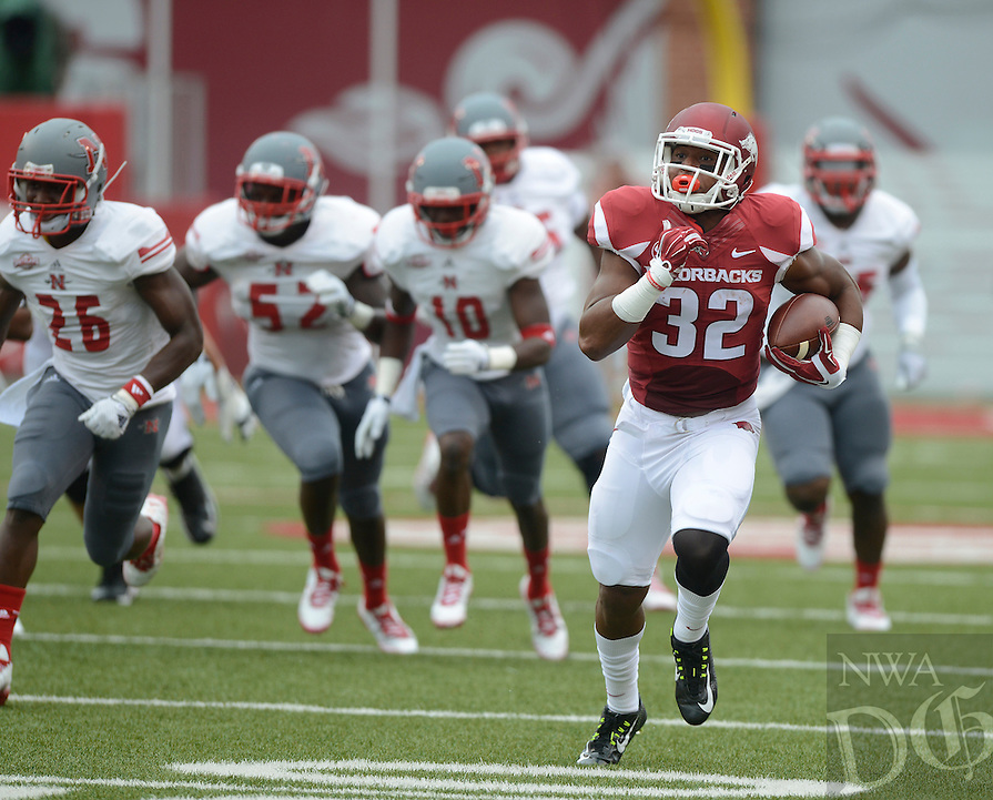 STAFF PHOTO ANTHONY REYES • @NWATONYR<br /> Johathan Williams, Razorbacks running back, outruns the Nicholls State defense in the first quarter Saturday, Sept. 6, 2014 at Razorback Stadium in Fayetteville.