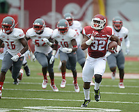 STAFF PHOTO ANTHONY REYES &bull; @NWATONYR<br /> Johathan Williams, Razorbacks running back, outruns the Nicholls State defense in the first quarter Saturday, Sept. 6, 2014 at Razorback Stadium in Fayetteville.
