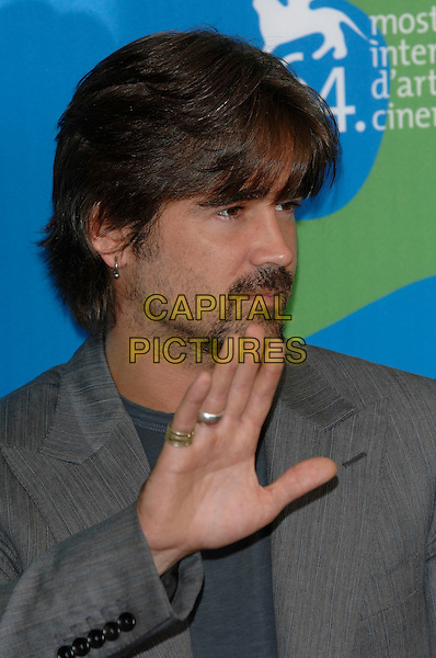 "COLIN FARRELL.Photocall for ""Cassandra's Dream"" at the 64th Venice Film Festival (La Biennale di Venezia), Venice, Italy..September 2nd, 2007,.headshot portrait stubble facial hair earrings hand palm waving rings .CAP/PL.©Phil Loftus/Capital Pictures"