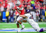 Indianapolis, IN - DEC 1, 2018: Ohio State Buckeyes running back Mike Weber (2) is tackled by Northwestern Wildcats linebacker Paddy Fisher (42) during first half action of the Big Ten Championship game between Northwestern and Ohio State at Lucas Oil Stadium in Indianapolis, IN. (Photo by Phillip Peters/Media Images International)