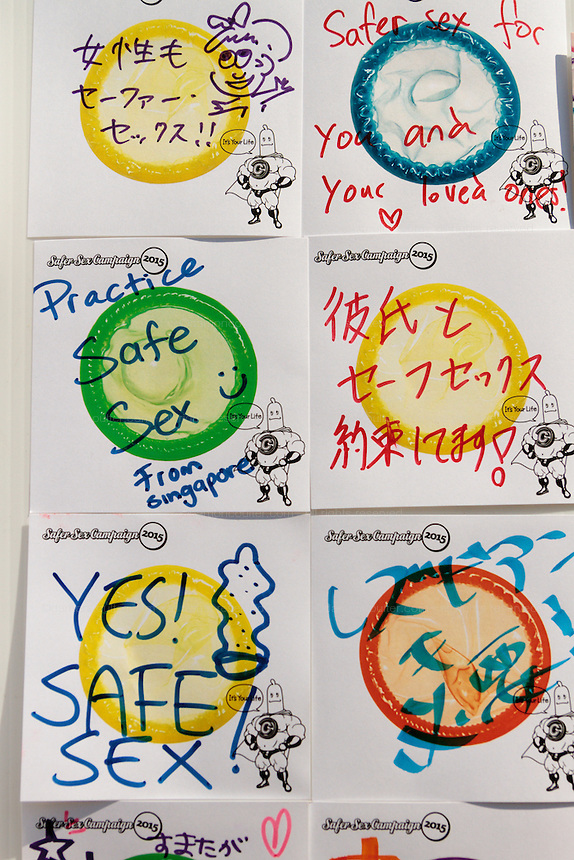 Messages of support for safe sex at a stall at The Rainbow Pride Event in Yoyogi Park, Shibuya, Tokyo, Japan. Sunday, April 26th 2015. This is the forth annual celebration of LGBT issues in Tokyo and forms part of a wider Rainbow Week. About 5% of the Japanese population identify as homosexual and this event hopes to foster a society where they can live equally and without prejudice.