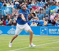 Mardy Fish (USA) against Andy Murray (GBR) (3) in the third round of the men's singles. Mardy Fish beat Andy Murray 6-4 1-6 7-6..Tennis - ATP World Tour - AEGON Championships - Queen's Club - London - Day 4 - Thur 10 Jun 2010..© AMN Images - Level 1, Barry House, 20-22 Worple Road, London, SW19 4DH.Tel - +44 (0) 208 947 0100.email - mfrey@advantagemedianet.com. www.photoshelter.com/c/amnimages.