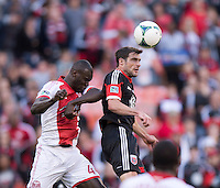 Chris Pontius (13) of D.C. United goes up for a header in the box with Pa Modou Kah (44) of the Portland Timbers during a Major League Soccer match at RFK Stadium in Washington, DC.  The Portland Timbers defeated D.C. United, 2-0.