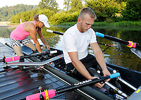 Former Marine sergeant Rob Jones, right, prepares to row with his partner Oksana Masters using a specially equipped double scull boat Wednesday July, 25, 2012 during training on the Rivanna River in Charlottesville, VA. Former Marine sergeant Jones, who lost both legs during an IED explosion in Afghanistan, will compete with Masters as rowers at the 2012 Paralympics in London, England. Rowing will make its appearance at the London Paralympic Games for only the second time, after its introduction at the Beijing 2008 Games. Photo/Andrew Shurtleff